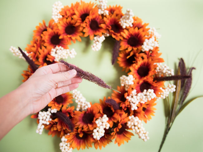 Adding cattails to fall wreath