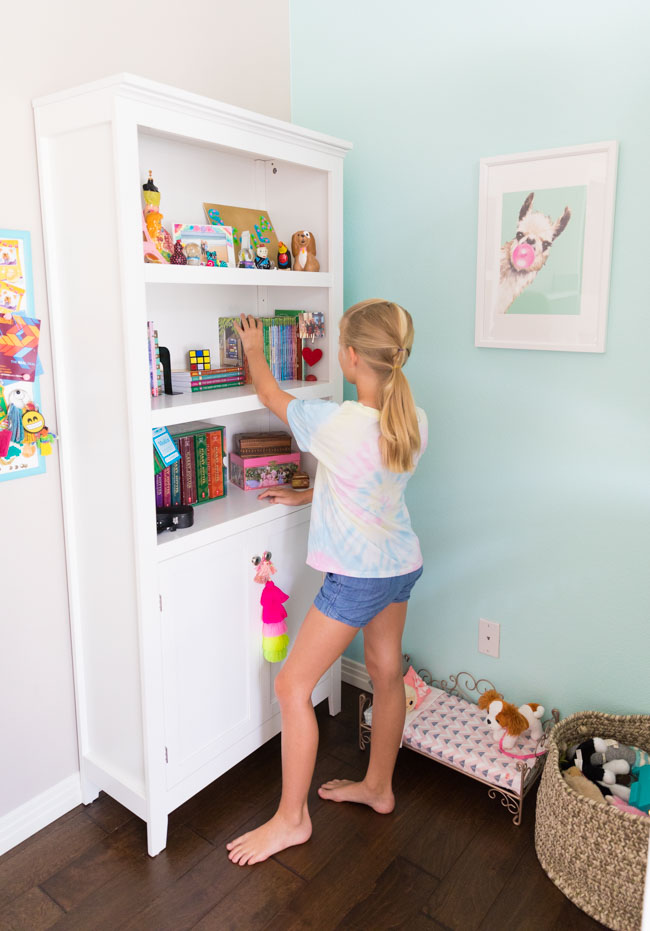 Target white bookcase in girls bedroom