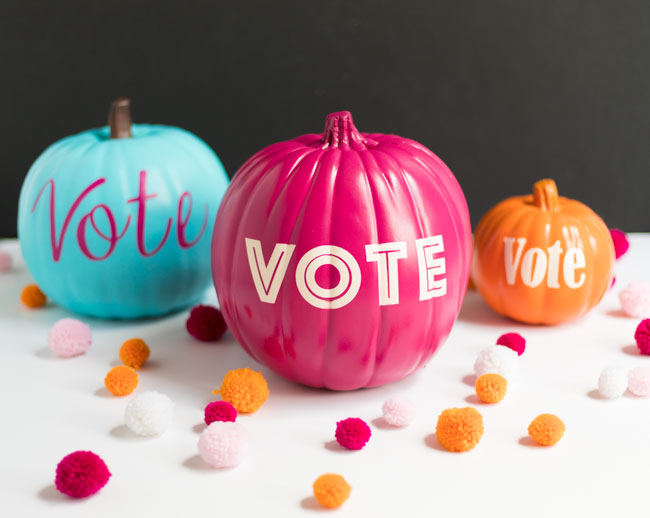 This is an image of pumpkins decorated with the word vote