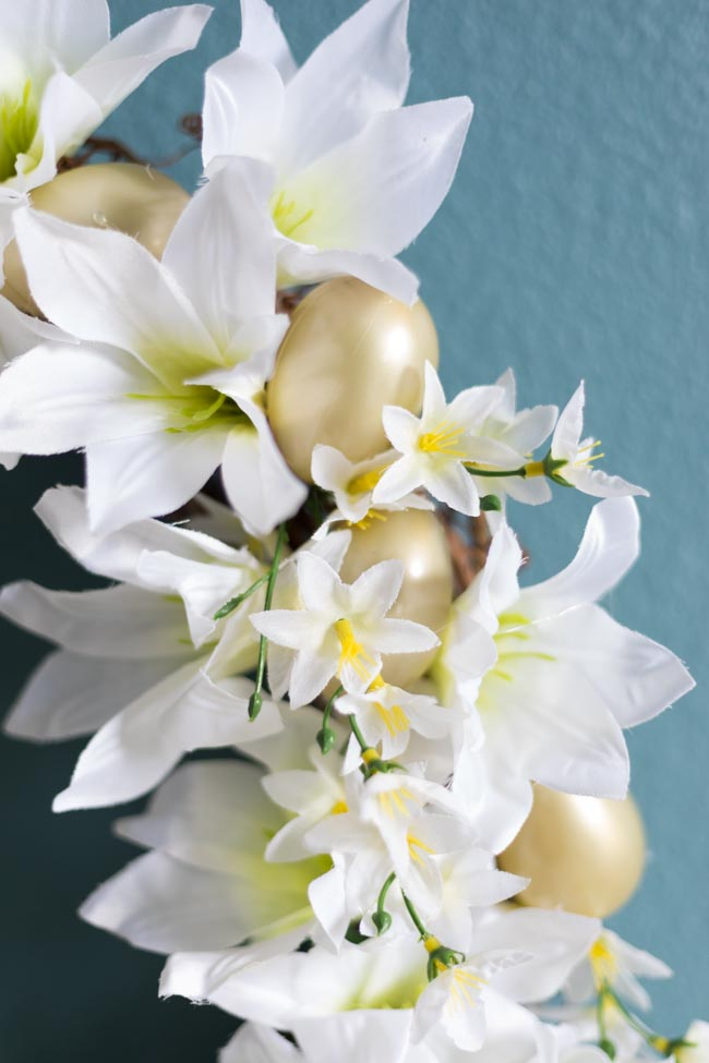 Wreath made with Easter lilies and gold eggs from Dollar Tree