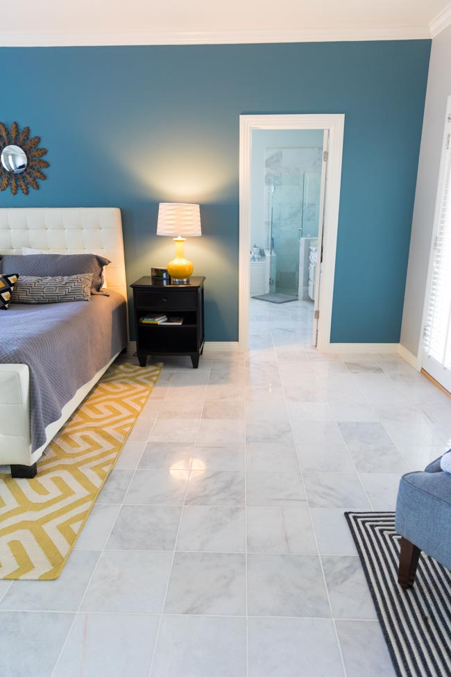 Master bedroom with polished Carrara marble