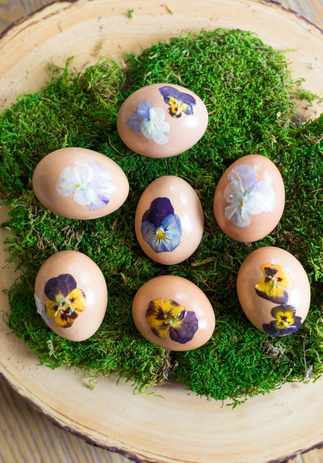 Nature inspired pressed flower Easter eggs on moss
