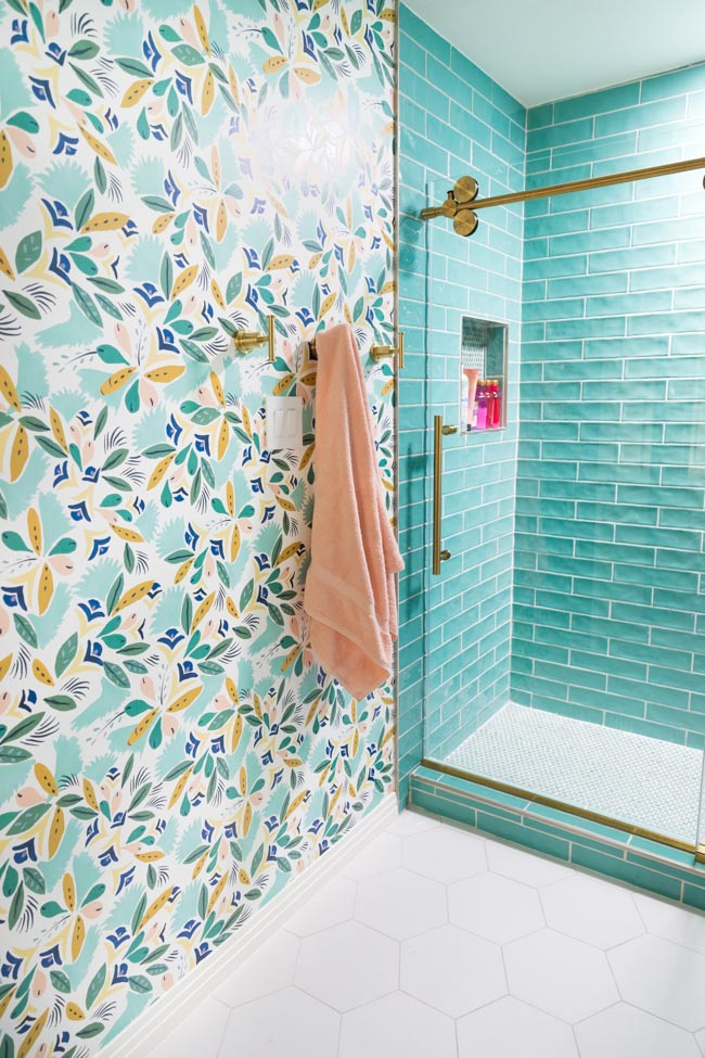 Girls bathroom with floral wallpaper